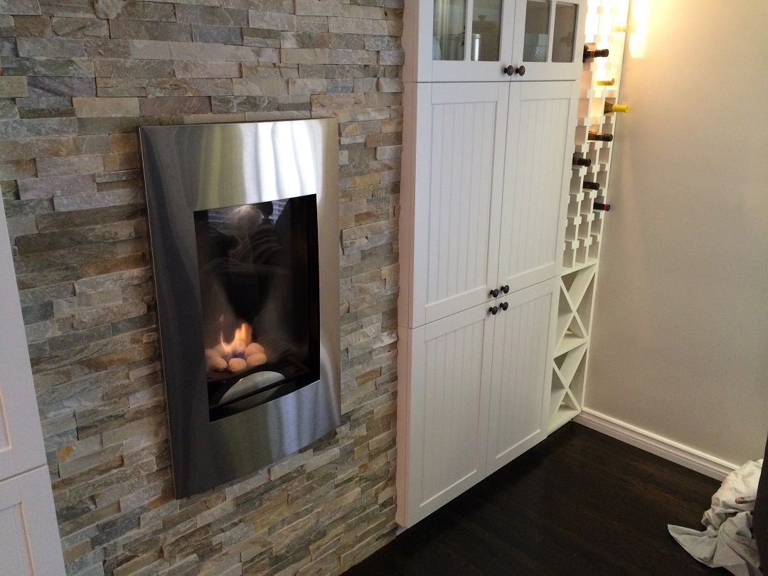 Modern fire place with ledgerstone and built-ins.